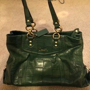 Green crocodile print leather tote bag.